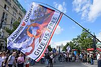 """29 AUG 2020, BERLIN/GERMANY:<br /> QAnon-Flagge, mit der Aufschrift """"Wladimir Donald Give us free"""", Demonstration gegen die Einschraenkungen in der Corona-Pandemie durch die Initiative """"Querdenken 711"""" aus Stuttgart unter dem Motto """"invites Europa - Fest für Freiheit und Frieden"""", Unter den Linden<br /> IMAGE: 20200829-01-037<br /> KEYWORDS: Demo, Protest, Demosntranten, Protester, COVID-19, Corona-Demo, Brandenburger Tor"""
