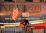 February 17, 2012 PEACHTREE CITY:  Scott Reagan hangs the Georgia flag before the start of the Newt Gingrich  rally in Hanger B4  at Peachtree City-Falcon Field in Peachtree City on  Friday, February 17, 2012.    ©2012 Johnny Crawford