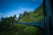 Blue train traveling from Ella to Kandy, Sri Lanka, Asia
