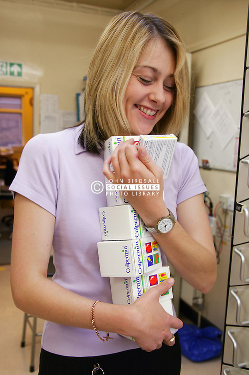 Pharmacy technician sorting out medication at the Main Hospital Pharmacy,