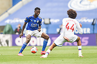 LEICESTER, ENGLAND - JULY 04: Wilfred Ndidi of Leicester City tries to find a way past Jairo Riedewald of Crystal Palace during the Premier League match between Leicester City and Crystal Palace at The King Power Stadium on July 4, 2020 in Leicester, United Kingdom. Football Stadiums around Europe remain empty due to the Coronavirus Pandemic as Government social distancing laws prohibit fans inside venues resulting in all fixtures being played behind closed doors. (Photo by MB Media)