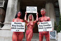 "© licensed to London News Pictures. London, UK 08/05/2012. Three models representing PETA, painted to resemble skinned and bloodied people, holding signs reading ""Hermès, Bag Cruelty: Ditch Leather"" and posing to protest against the leather industry, outside the opening of the ""Hermès Leather Forever"" exhibition at the Royal Academy of Arts today (08/05/12) Model names: (left to right) Maria Harris, Katy Heffernan Smith, Nike Verba. Photo credit: Tolga Akmen/LNP"