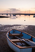 Dusk light at low tide, Brancaster Staithe. North Norfolk, East Anglia, England, UK