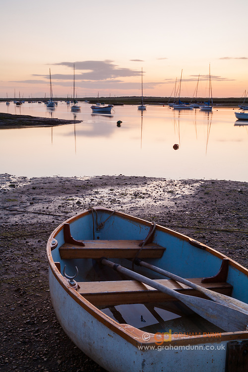 Dusk light at low tide, Brancaster Staithe. North Norfolk, East Anglia, England, UK