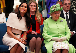 Queen Elizabeth II and the Duchess of Sussex on a tour of the Storyhouse Chester before unveiling a plaque to mark the official opening of the building.