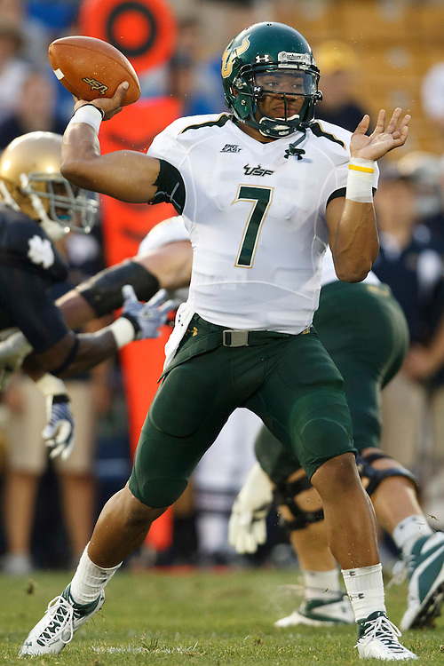 South Florida quarterback B.J. Daniels (#7) throws pass in action during NCAA football game between Notre Dame and South Florida.  The South Florida Bulls defeated the Notre Dame Fighting Irish 23-20 in game at Notre Dame Stadium in South Bend, Indiana.