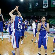 Anadolu Efes's players celebrate victory during their Turkish Basketball League match Darussafaka Dogus between Anadolu Efes at Ayhan Sahenk Arena in Istanbul Turkey on Wednesday 29 April 2015. Photo by Kurtulus YILMAZ/TURKPIX