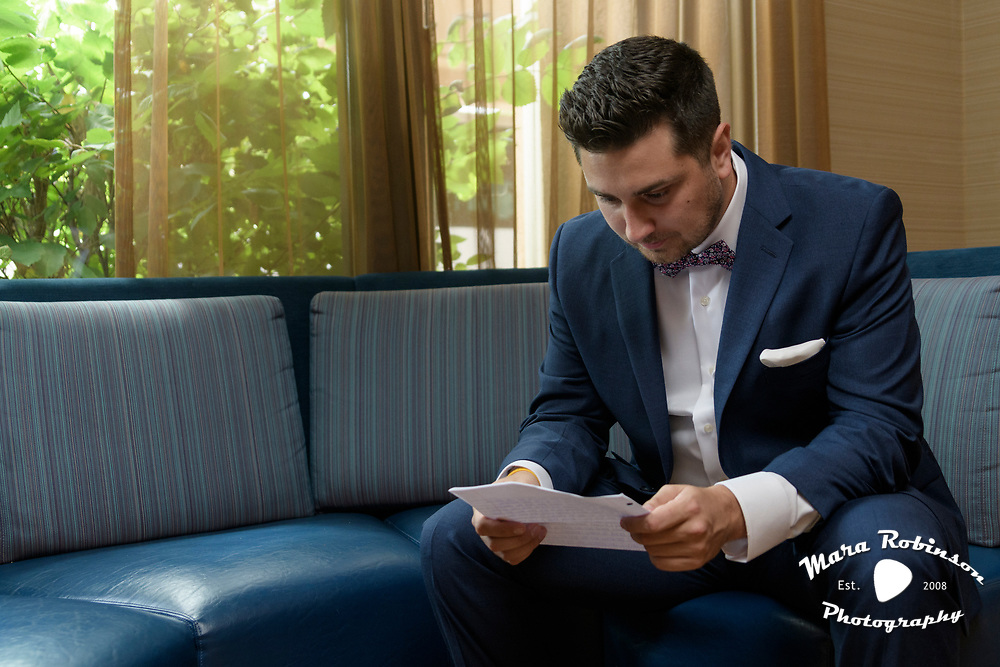 Groom reading a love letter from his bride by Tallmadge wedding photographer, Akron wedding photographer Mara Robinson Photography