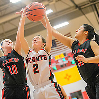 022515  Adron Gardner/Independent<br /> <br /> Grants Pirate Chali Simpson (2), center, and Albuquerque Academy Chargers Kristen Woodworth (10), left, and Lexy Hernandez (35) vie for a rebound at Grants High School Wednesday.