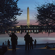 WASHINGTON DC--Photographers waiting for the sunrise over the Tidal Basin during the annual flowering of Washington DC's famous cherry blossoms.