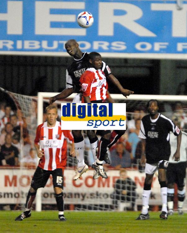 Photo: Ed Godden.<br /> Brentford v Swansea City. Coca Cola League 1. 12/09/2006. Gavin Tomlin (R) and Swansea's Ezomo Iriekpen both jump for the ball.