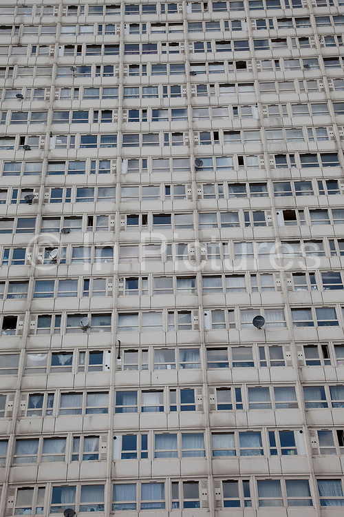 Windows of a council flat housing block in Deptford, South East London. This high rise block is in some disrepair.