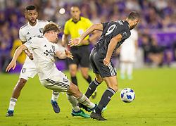 April 21, 2018 - Orlando, FL, U.S. - ORLANDO, FL - APRIL 21: San Jose Earthquakes midfielder Florian Jungwirth (23) clears a ball from Orlando City forward Justin Meram (9) during the MLS soccer match between the Orlando City FC and the San Jose Earthquakes at Orlando City SC on April 21, 2018 at Orlando City Stadium in Orlando, FL. (Photo by Andrew Bershaw/Icon Sportswire) (Credit Image: © Andrew Bershaw/Icon SMI via ZUMA Press)