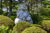 Rakan Statue at Jorenji Temple - Jodo sect temple in Akatsuka ,Itabashi, Tokyo known for its  Tokyo Big Buddha usually referred to as Akatsuka Daibutsu or Tokyo Big Buddha.  In addition to the Big Buddha at Joren-ji, there is also a very large rakan Buddha's disciple statue and an adacent Japanese pond garden with a unique pavilion in it.  The large Buddha itself is made of bronze with a height of 13 meters and weighs 32 tons. - the third largest in Japan.