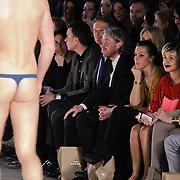NLD/Amsterdam/20120125 - AFW winter 2012 - show Sjaak Hullekes, Victoria Koblenko kijkt naar model in lingerie