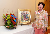 "Carolyn Temmallo interpreted each detail into her floral composition of ""Le Sacre du Printemps"" (The Rite of Spring) painted by JR Bothhamley at the 6th annual Art 'N Bloom by Opechee Garden Club Thursday evening at Gilford Public Library.    (Karen Bobotas/for the Laconia Daily Sun)"