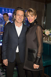 STEPHEN WEBSTER and ASSIA WEBSTER at a party to celebrate the launch of the Lisa Snowdon jewellery collection for QVC held at Sexy Fish, Berkeley Square, London on 12th January 2016.