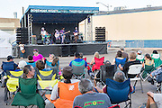 People gather to listen to a free concert during Bohemian Nights on Thursdays in the Old Town historic shopping and restaurant district in Fort Collins, Colorado.