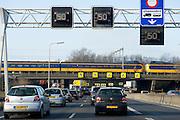 Filevorming op de A16, ring Rotterdam. Trein passeert de file - Traffic arround Rotterdam, Netherlands