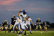 Zach Bronkhorst (12) of the Dallas Lutheran Lions throws a pass against the McKinney Christian Academy Mustangs at McKinney North High School in McKinney on Friday, September 13, 2013. (Cooper Neill/Special Contributor)