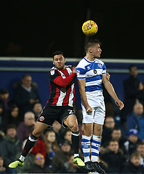 Queens Park Rangers' Niko Hamalainen and Sheffield United's George Baldock going up for ball during the game during the Sky Bet Championship match at Loftus Road, London.