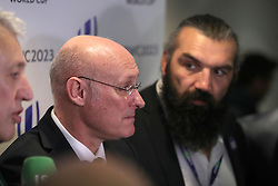 Sebastien Chabal (right) looks on as French Rugby Federation President Bernard Laporte (centre) and France 2023 bid president Claude Atcher (left) speak during the 2023 Rugby World Cup host union announcement at The Royal Garden Hotel, Kensington.