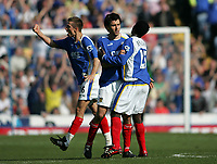 Photo: Lee Earle.<br /> Portsmouth v Sunderland. The Barclays Premiership. 22/04/2006. Pompey's Svetoslav Todorov (C) is congratulated by Benjani Mwaruwari.