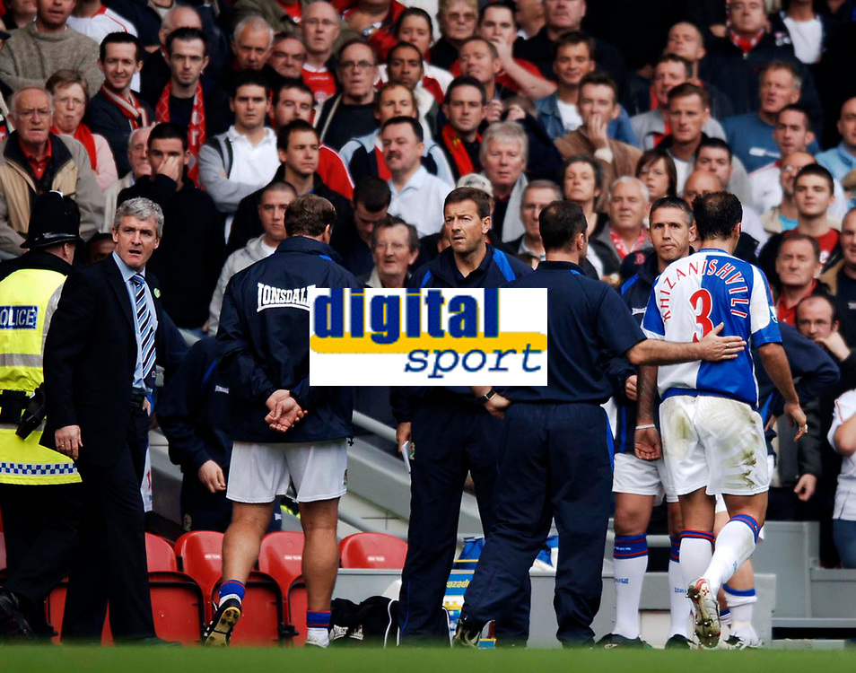 Photo: Glyn Thomas.<br />Liverpool v Blackburn Rovers. The Barclays Premiership.<br />15/10/2005.<br />Blackburn's Zurab Khizanishvili (R) leaves the field after being shown the red card as his side's manager Mark Hughes (L) looks less than pleased.