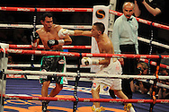featherweight WBC world title eliminator.<br /> Lee Selby of Wales (r) v Romulo Koasicha of Mexico'The second coming'  boxing event at the Motorpoint Arena in Cardiff, South Wales on Sat 17th May 2014. <br /> pic by Andrew Orchard, Andrew Orchard sports photography.