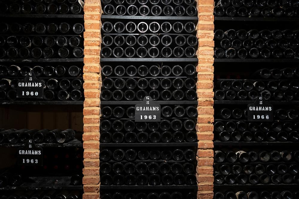 Bottles of vintage port 1960, 1963, 1966, in racks at wine cellars of Graham's Port Lodge in V|la Nova de Gaia in Porto, Portugal