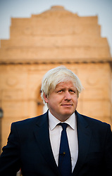 The London Mayor Boris Johnson during a Sky News interview at the India Gate, New Delhi, on day one of his 6 day tour of India, Sunday November 25, 2012. Photo by Andrew Parsons / i-Images