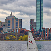 Boston skyline photography featuring iconic landmarks along the Charles River, such as the Prudential Center and 200 Clarendon better known as the John Hancock Building. Partly cloudy skies were in the weather forecast and a bit hesitant to explore, but boy am I glad I went. The sailing boat added a colorful punch while the overcast sky showed beautiful grey tones and different cloud formations. <br /> This overcast Boston skyline photo is available as museum quality photography prints, canvas prints, acrylic prints or metal prints. Wall art prints may be framed and matted to the individual liking and decorating needs:<br />  <br /> https://juergen-roth.pixels.com/featured/boston-with-a-chance-of-rain-juergen-roth.html<br /> <br /> All overcast Boston photos are available for digital and print photography image licensing at www.RothGalleries.com. Please contact me direct with any questions or request.<br /> <br /> Good light and happy photo making!<br /> <br /> My best,<br /> <br /> Juergen<br /> Prints: http://www.rothgalleries.com<br /> Photo Blog: http://whereintheworldisjuergen.blogspot.com<br /> Instagram: https://www.instagram.com/rothgalleries<br /> Twitter: https://twitter.com/naturefineart<br /> Facebook: https://www.facebook.com/naturefineart