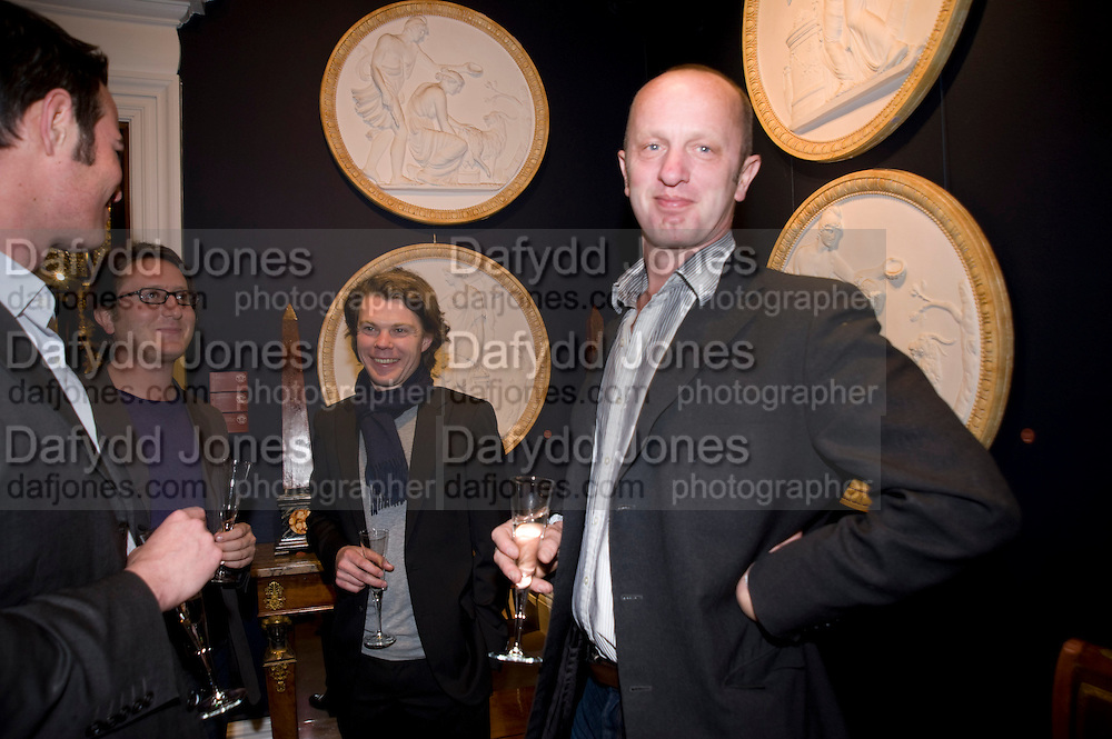 GRAHAM STEELE; LAURENCE KAVANAGH; JOHNNIE SHAND KYDD, Preview party for the Versace Sale.  The contents of fashion designer Gianni Versace's villa on Lake Como. Sothebys. Old Bond St. London. 16 March 2009.  *** Local Caption *** -DO NOT ARCHIVE -Copyright Photograph by Dafydd Jones. 248 Clapham Rd. London SW9 0PZ. Tel 0207 820 0771. www.dafjones.com<br /> GRAHAM STEELE; LAURENCE KAVANAGH; JOHNNIE SHAND KYDD, Preview party for the Versace Sale.  The contents of fashion designer Gianni Versace's villa on Lake Como. Sothebys. Old Bond St. London. 16 March 2009.