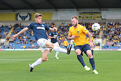 Southend United's Kevan Hurst clears from Oxford United's Sean Rigg - Photo mandatory by-line: Nigel Pitts-Drake/JMP - Tel: Mobile: 07966 386802 05/10/2013 - SPORT - FOOTBALL - Kassam Stadium - Oxford - Oxford United v Southend United - Sky Bet League 2