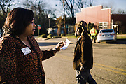UNIONTOWN, AL – DECEMBER 11, 2019: After an informational gathering, Keshee Dozier-Smith (left), 34, is stopped in the street by an elderly gentleman who expresses interest in the healthcare services offered by Rural Health Medical Program.<br /> <br /> Since joining Rural Health Medical Program as Chief Executive Officer in March 2016, Dozier-Smith has effectively moderned the 35-year-old floundering business – opening three new clinics, streamlining processes and reaching out to local companies to offer healthcare services for employees. In the wake of rising hospital closures that leave Alabama's poorest citizens disproportionately cut off from access to medical care, Dozier-Smith represents a renewed effort to bridge the rural gap by offering a quality, affordable healthcare option.