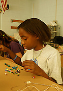 Teen Girls Work at Art Projects at Community Art Program