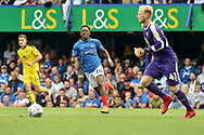 Portsmouth Midfielder, Jamal Lowe (10) closes down Oxford United Goalkeeper, Jonathan Mitchell (41) during the EFL Sky Bet League 1 match between Portsmouth and Oxford United at Fratton Park, Portsmouth, England on 18 August 2018.