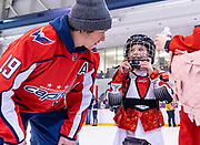 Washington Capitals forward Nicklas Backstrom chats with a young girl during the team's annual skate with Dream for Kids DC at MedStar Capitals Iceplex on February 7, 2020. The organization provides life-changing activities for children with physical and developmental disabilities.