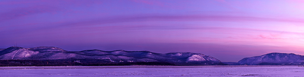 A stitched panoramic of the eastern Hudson Highlands and frozen Hudson River in winter from Newburgh, NY