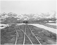 """View from south switch of the south end of the RGS snowshed and section house with the snow fences at Lizard Head Pass.<br /> RGS  Lizard Head, CO  after 1951<br /> In book """"Rio Grande Southern II, The: An Ultimate Pictorial Study"""" page 275"""