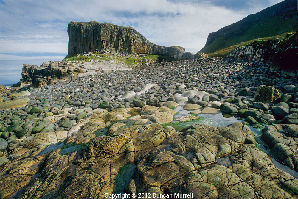 This is the pebbly beach and stack at the northern tip of the island near where I was camping. The steep escarpment that fringed the eastern half of the island can be seen in the background. I can imagine that the Inner Hebrides is a geologist's paradise. I can only profess to having a keen layman's interest in geology; physical geography was one of my favourite subjects at school, and I always find myself trying to remember and identify geomorphological features on my travels.