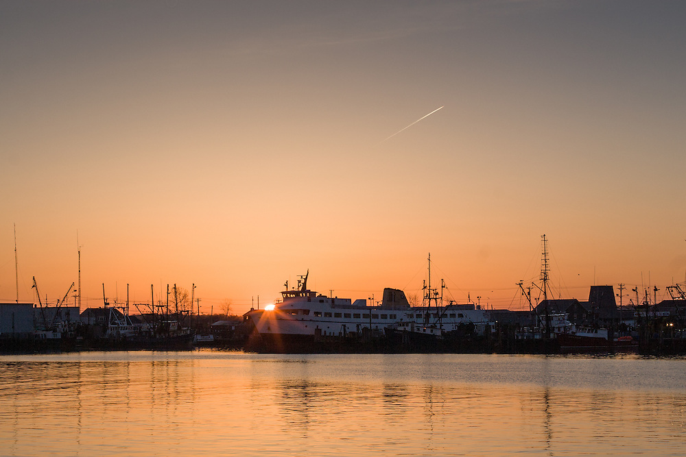Sunrise over the port of Galilee and the Block Island Ferry.