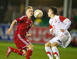 RHYL, WALES - Tuesday, March 18, 2014: Wales' Matty Smith in action against Poland's Patryk Romanski during the Under-15's International Friendly match at Belle Vue. (Pic by David Rawcliffe/Propaganda)