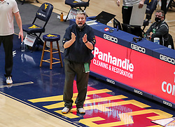 Feb 13, 2021; Morgantown, West Virginia, USA; West Virginia Mountaineers head coach Bob Huggins yells from the bench during the second half against the Oklahoma Sooners at WVU Coliseum. Mandatory Credit: Ben Queen-USA TODAY Sports