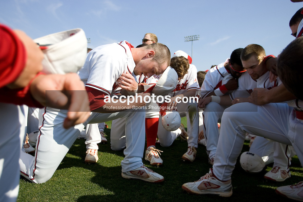 09 March 2007: North Carolina State Wolfpack Jeremy Synan (center) leads the team in prayer before a 6-3 Maryland Terrapins victory over the North Carolina State Wolfpack at Doak Field in Raleigh, NC.