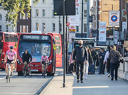 © Licensed to London News Pictures. 02/09/2020. London, UK. Commuters head to work by foot, bike, bus, and car in Putney, South West London as schools start for the first time in 6 months. Boris Johnson has called for workers to get back to their offices to help revive the economy and local service industries as the coronavirus crisis continues. Photo credit: Alex Lentati/LNP