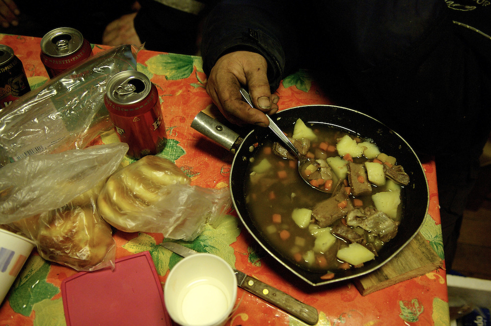 Hirvas Salmi, FINLAND. Veggai, 58, of Lemmenokki, enjoys a dinner of reindeer and potato stew.  The staple dish of the Sami, it remains unchanged for hundreds of years.