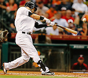 Aug 6, 2012; Houston, TX; USA; Houston Astros shortstop Marwin Gonzalez (9) hits a solo home run against the Washington Nationals in the first inning at Minute Maid Park. Mandatory Credit: Thomas Campbell-US PRESSWIRE