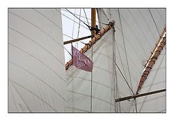 Fife Regatta flag on Altair..The Round the Cumbraes race to open the regatta. Light variable breeze and grey skies shrouded the fleet with a strong spectator fleet...* The Fife Yachts are one of the world's most prestigious group of Classic .yachts and this will be the third private regatta following the success of the 98, .and 03 events.  .A pilgrimage to their birthplace of these historic yachts, the 'Stradivarius' of .sail, from Scotland's pre-eminent yacht designer and builder, William Fife III, .on the Clyde 20th -27th June.   . ..More information is available on the website: www.fiferegatta.com . .Press office contact: 01475 689100         Lynda Melvin or Paul Jeffes