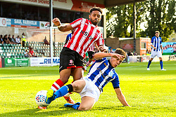 Matt Green of Lincoln City is tackled by Alex Hunt of Sheffield Wednesday - Mandatory by-line: Robbie Stephenson/JMP - 13/07/2018 - FOOTBALL - Sincil Bank Stadium - Lincoln, England - Lincoln City v Sheffield Wednesday - Pre-season friendly